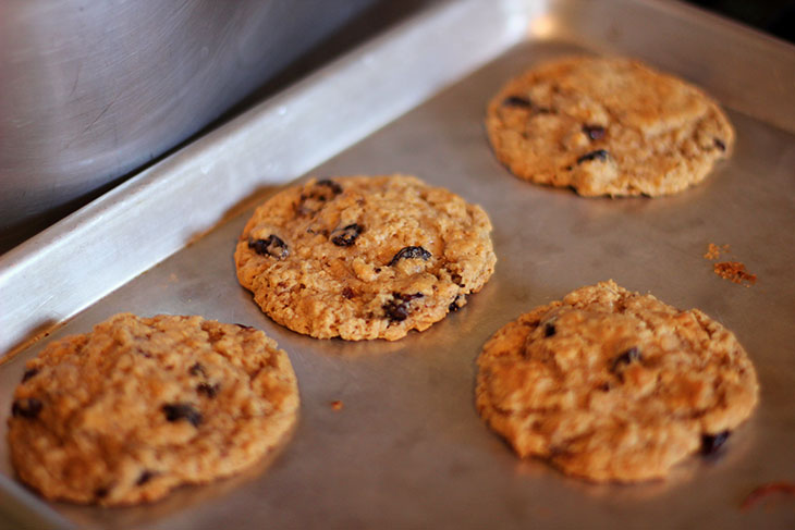 Freshly baked Gluten Free Oatmeal Raisin Cookies on baking pan
