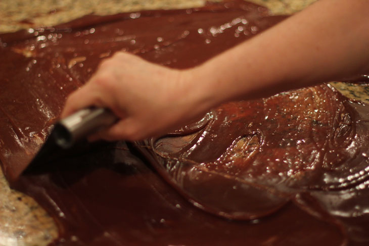 Metal scraper kneading gluten free old-fashioned mint chocolate fudge
