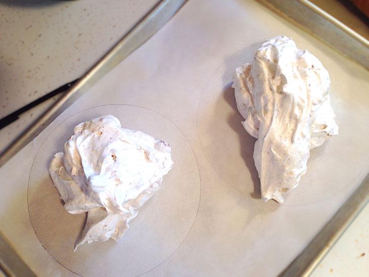 Strawberry hazelnut torte on parchment paper, ready to be shaped